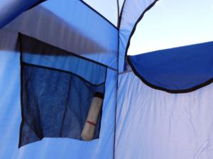 Mesh bag inside shower tent