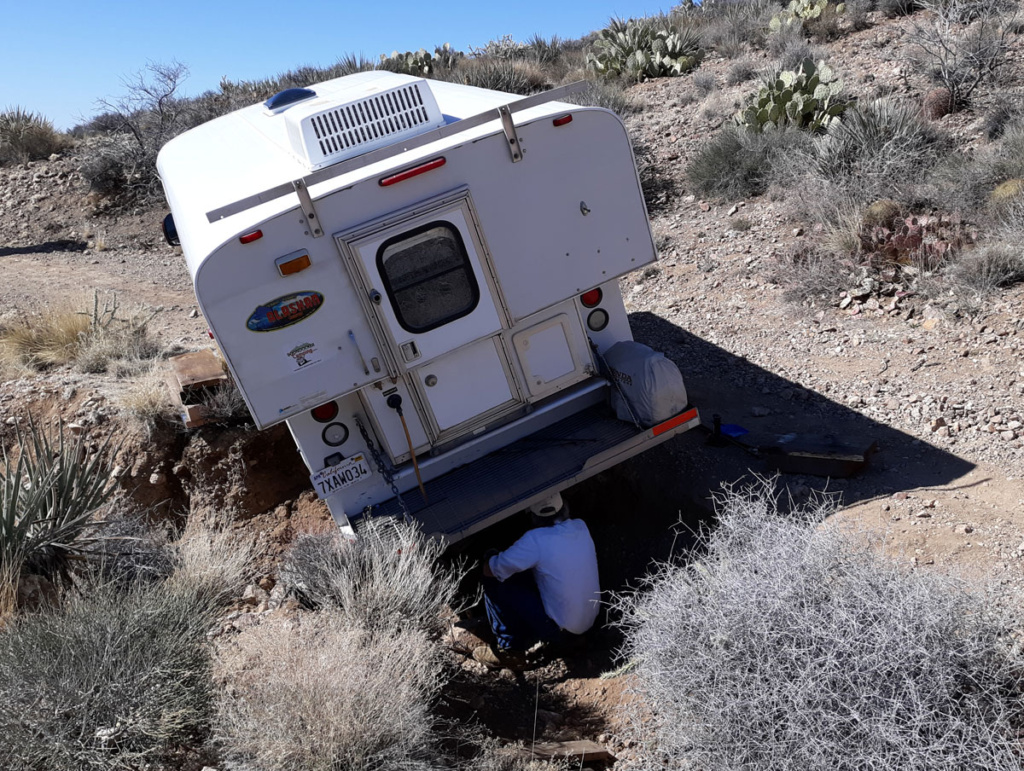 Truck camper stuck in desert ditch