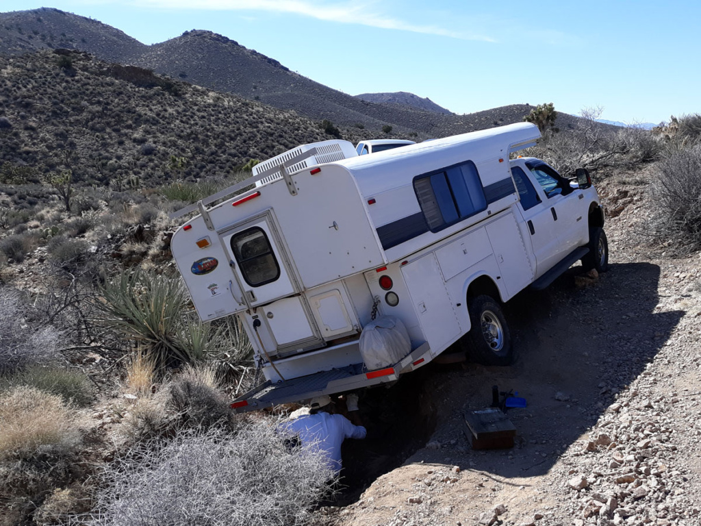 Truck camper stuck on desert road