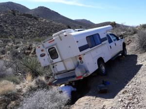 Truck camper stuck on desert road